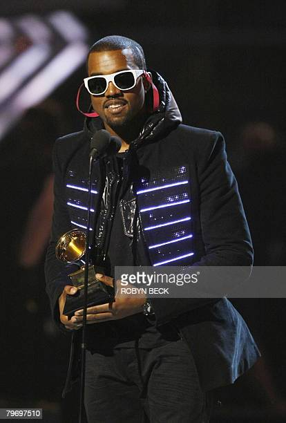 2008 winner for Best Rap Album Kanye West accepts the trophy at the 50th Grammy Awards in Los Angeles on February 10 2008 West won Grammys for Best...