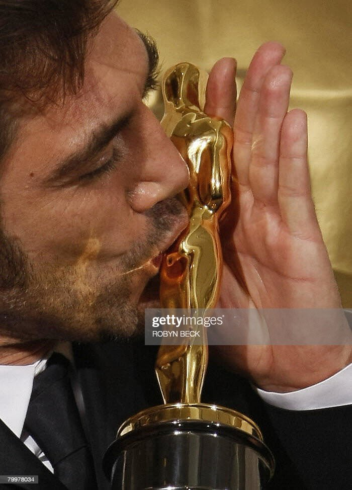 Winner for Best Supporting Actor ('No Country For Old Men') Javier Bardem kisses the trophy during the 80th Annual Academy Awards at the Kodak Theater in Hollywood, California on February 24, 2008.