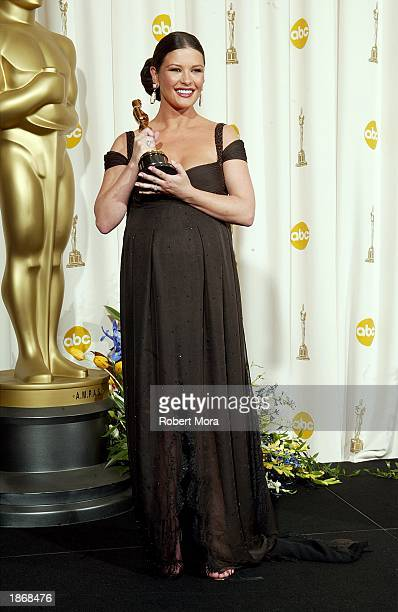 Winner for Best Supporting Actress Catherine ZetaJones poses backstage during the 75th Annual Academy Awards at the Kodak Theater on March 23 2003 in...