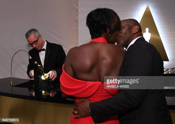 Winner for Best Supporting Actress 'Fences' Viola Davis and her husband wait for her Oscar statue to be engraved at the 89h Annual Academy Awards...