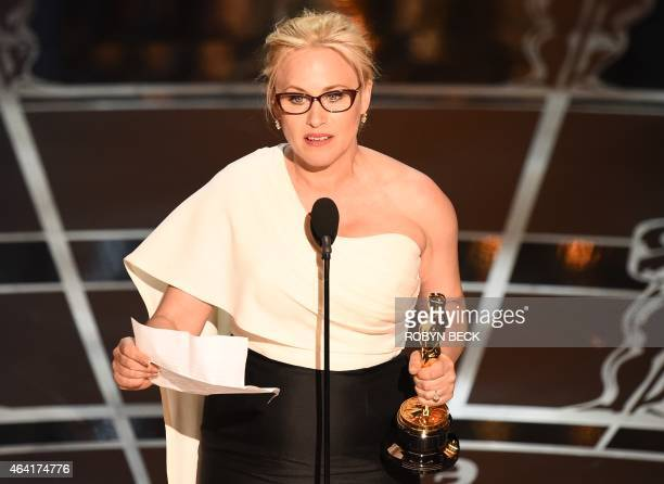 Winner for Best Supporting Actress Patricia Arquette accepts her award on stage at the 87th Oscars February 22, 2015 in Hollywood, California. AFP...