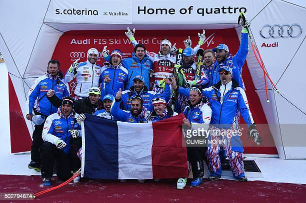Winner France's Adrien Theaux and thirdplaced France's David Poisson celebrate with their team after the podium ceremony of the FIS Alpine World Cup...