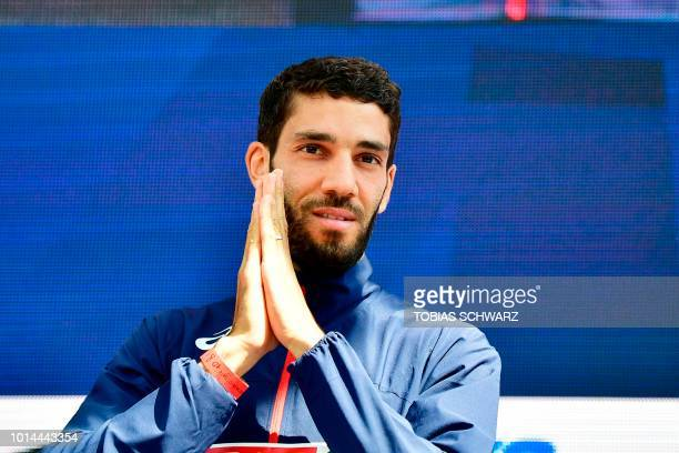 Winner France's Mahiedine MekhissiBenabbad poses on the podium during the medal ceremony for the Men's 3000m Steeplechase during the European...