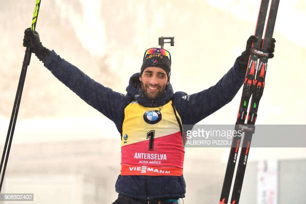 TOPSHOT Winner France's Martin Fourcade celebrates on the podium of the Men 15 km Mass Start Competition of the IBU World Cup Biathlon in Anterselva...
