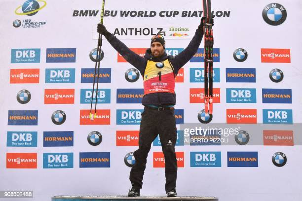 Winner France's Martin Fourcade celebrates on the podium of the Men 15 km Mass Start Competition of the IBU World Cup Biathlon in Anterselva on...