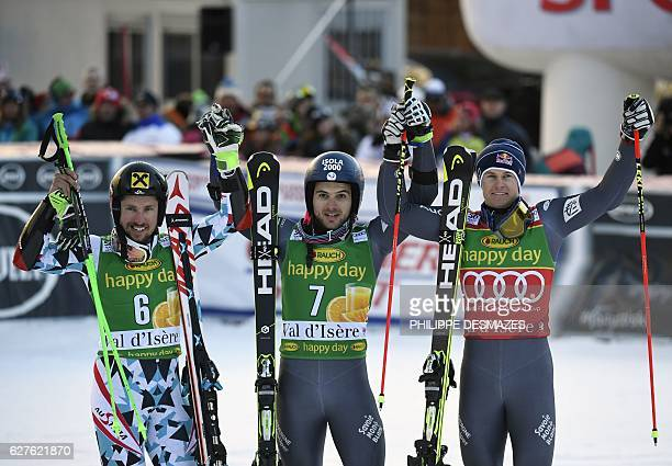 Winner France's Mathieu Faivre secondplaced Austria's Marcel Hirscher and thirdplaced France's Alexis Pinturault celebrate after the FIS Alpine World...