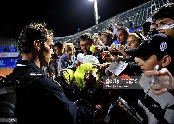 Winner Frantisek Cermak of Czech Republic signs autographs after beating Johan Brunstrom of Sweden and Jean-Julien Rojer of Netherlands Antilles...