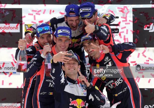 Winner French driver Sebastien Ogier takes a selfie photo with his French codriver Julien Ingrassia and Belgian codriver Nicolas Gilsoul Belgian...