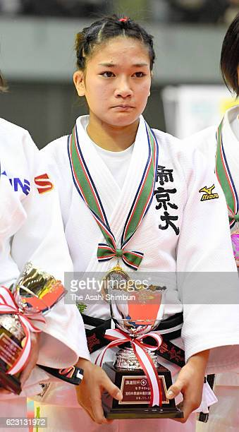 Winner Funa Tonaki poses on the podium at the medal ceremony for the Women's 48kg during day two of the Kodokan Cup All Japan Judo Championships by...