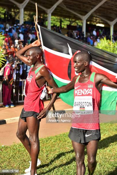 Winner Geoffrey Kipsang and second place finisher Leonard Kiplimo Barsoton of Kenya celebrate after men's race during the 27th World Cross Country...