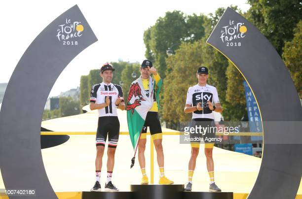 Winner Geraint Thomas of Great Britain Second Placed Tom Dumoulin of The Netherlands and third placed Chris Froome of Great Britain celebrate on the...