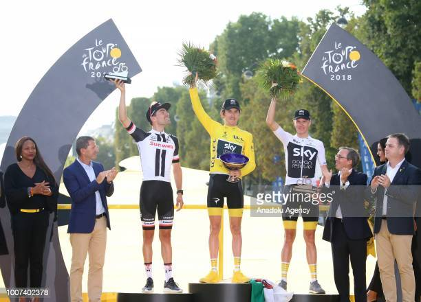 Winner Geraint Thomas of Great Britain, Second Placed Tom Dumoulin of The Netherlands and third placed Chris Froome of Great Britain celebrate on the...