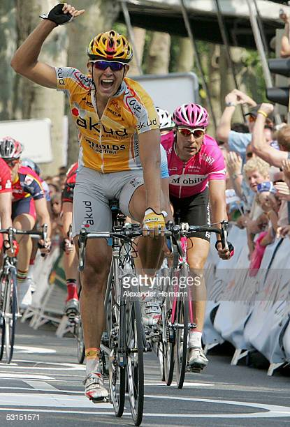 Winner Gerald Ciolek from team Akud Arnold celebrates while third placed Erik Zabel from Team T-Mobile looks disappointed during the Cycling German...