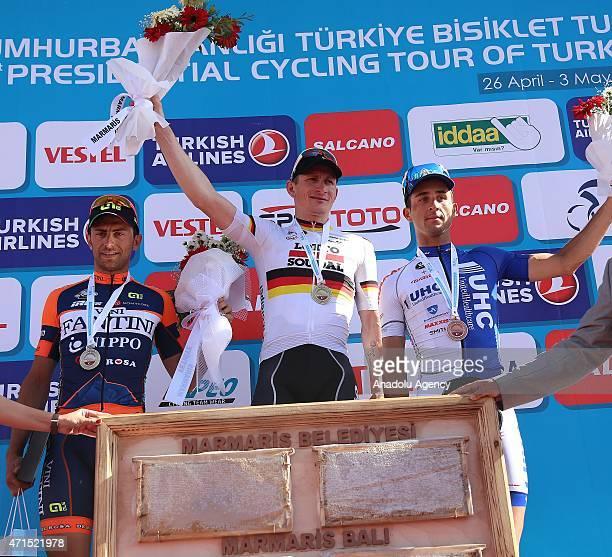Winner German cyclist Andre Greipel of Lotto Soudal, second Italian cyclist Daniele Colli of Nippo-Vini Fantini team and Italian cyclist Danielle...