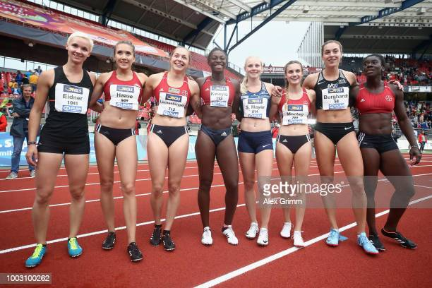 Winner Gina Lueckenkemper of TSV Bayer 04 Leverkusen and the other starters pose after the women's 100 metres final during day 2 of the German...