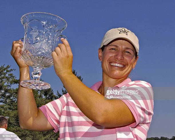 Winner Heather Bowie holds the champion's trophy after the final round of the Jamie Farr Owens Corning Classic July 10 2005 Bowie won the tournament...