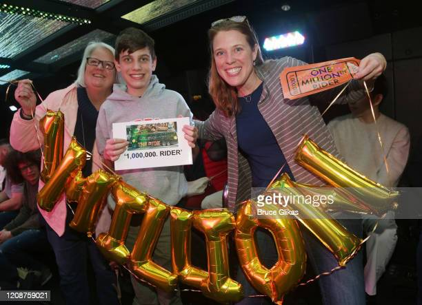 Winner Heather Hurley and family Cheryl Hurley and Will Hurley pose as The Ride welcomes it's 1000th Rider on the immersive bus tour of NYC on...