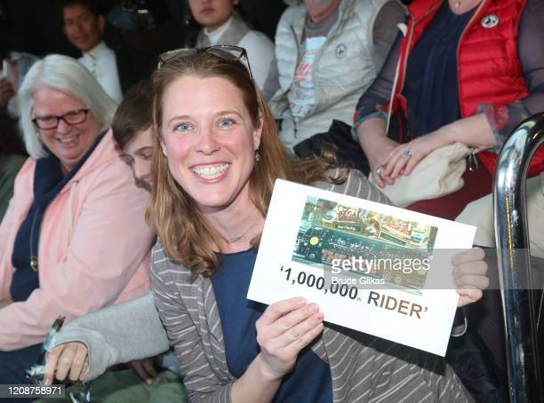 Winner Heather Hurley poses as The Ride welcomes it's 1000th Rider on the immersive bus tour of NYC on February 25 2020 in New York City