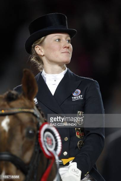 Winner Helen Langehanenberg of Germany celebrates with her horse Damon Hill after winning the FEI World Cup dressage event at the Jumping Amsterdam...