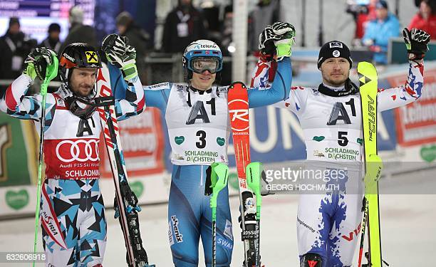 Winner Henrik Kristoffersen of Norway second placed Marcel Hirscher of Austria and third placed alexander Khoroshilov of Russia pose on the podium...