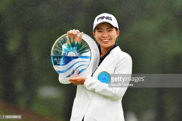Winner Hinako Shibuno of Japan poses with the trophy after the award ceremony following the final round of the Shiseido Anessa Ladies Open at Totsuka...