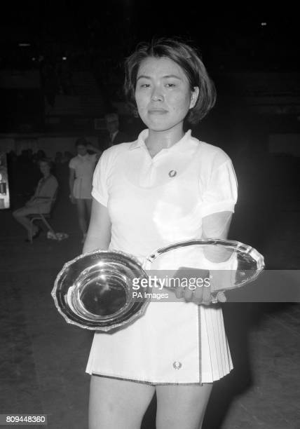 Winner Hiroe Yuki from Japan with her trophy after beating compatriot Noriko Takagi in the final to become champion