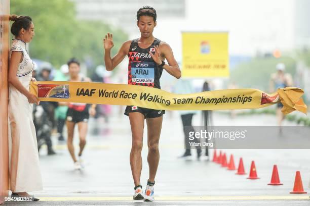 Winner Hirooki Arai of Japan crosses the finish line during Men's 50 kilometres Race Walk of IAAF World Race Walking Team Championships Taicang 2018...