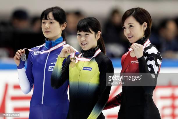 Winner Hitomi Saito celebrates with runnerup Yuki Kikuchi and thirdplaced Ayuko Ito at the award ceremony for the Ladies' 1000m competition during...