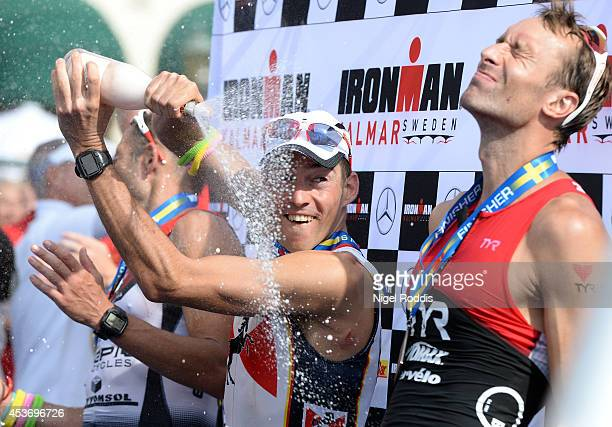 Winner Horst Reichel of Germany celebrates with second place Viktor Zyemtsev of Ukraine and third placed Tom Lowe of Britain at Ironman Kalmar on...