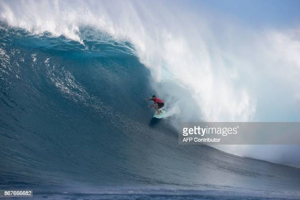 Winner Ian Walsh of Hawaii rides a big wave on the final day of World Surf League's big wave event off the coast of the Maui Island in Hawaii on the...