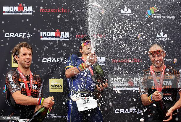 Winner Igor Amorelli of Brazil second place Mark Oude Bennick of Netherlands and third place Bas Diederen of Netherlands celebrate after Ironman...