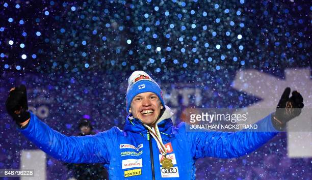 Winner Iivo Niskanen of Finland poses during a medal ceremony after the men's cross-country 15 km individual classic of the FIS Nordic Ski World...