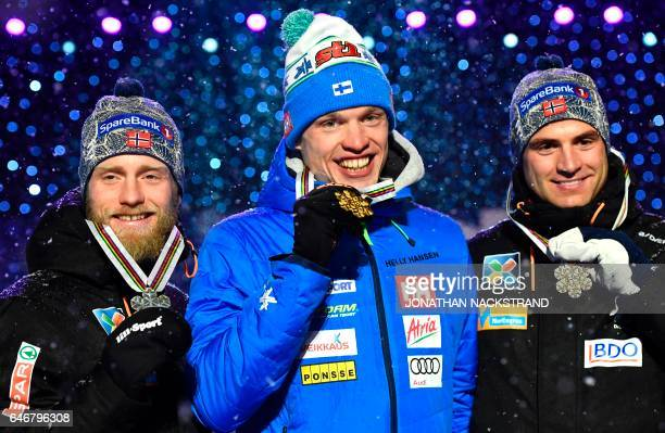Winner Iivo Niskanen of Finland , second placed Martin Johnsrud Sundby of Norway and third placed Niklas Dyrhaug of Norway pose with medals during a...