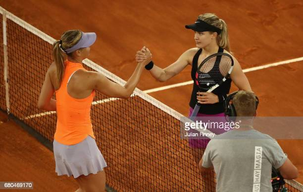 Winner in three sets Eugenie Bouchard of Canada shakes hands with Maria Sharapova of Russia during day three of the Mutua Madrid Open tennis at La...