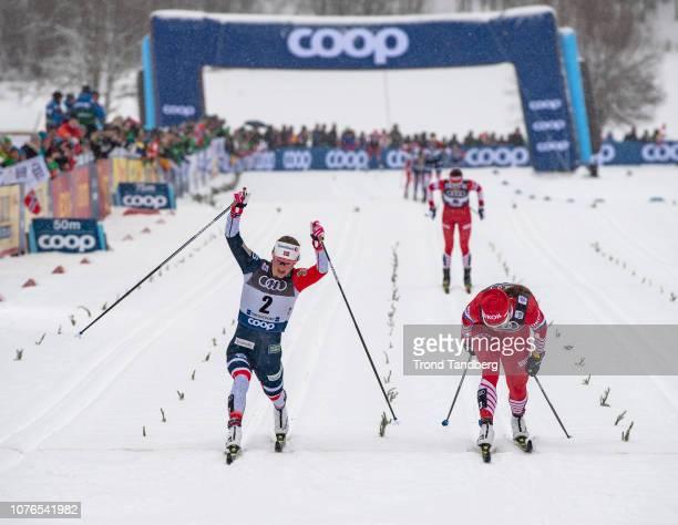Winner Ingvild Flugstad Ostberg of Norway and Natalia Nepryaeva of Russia cross the finish line during Tour de Ski Ladies 100 km Mass Start Classic...