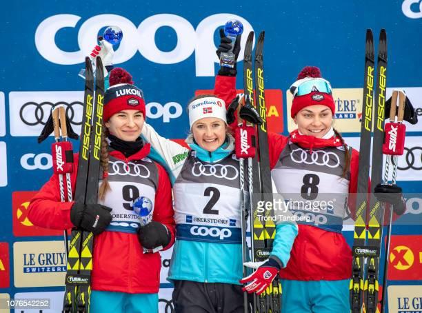 Winner Ingvild Flugstad Ostberg of Norway with Natalia Nepryaeva Anastasia Sedova of Russia after Tour de Ski Ladies 100 km Mass Start Classic on...