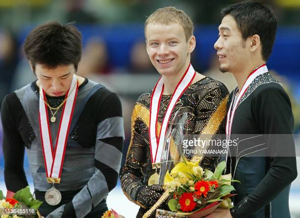 Winner Iria Klimkin of Russia shares a smile with thirdplacer Li Chengjiang of China while secondplacer Japanese Takeshi Honda bows his head during...