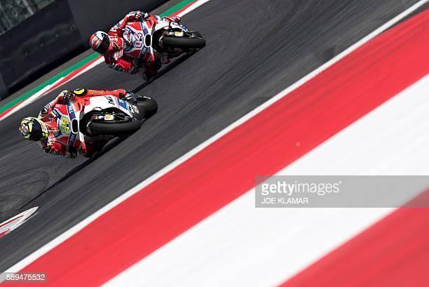 Winner Italian rider Andrea Iannone of Ducati Team and second placed Italian rider Andrea Dovizioso of Ducati team race during the MotoGP competition...