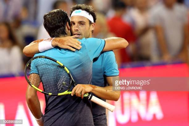 Winner Italia's Marco Cecchinato congratulates Argentina's Guido Pella at the end of their Umag 2018 ATP 250 tennis final match in Umag on July 22...