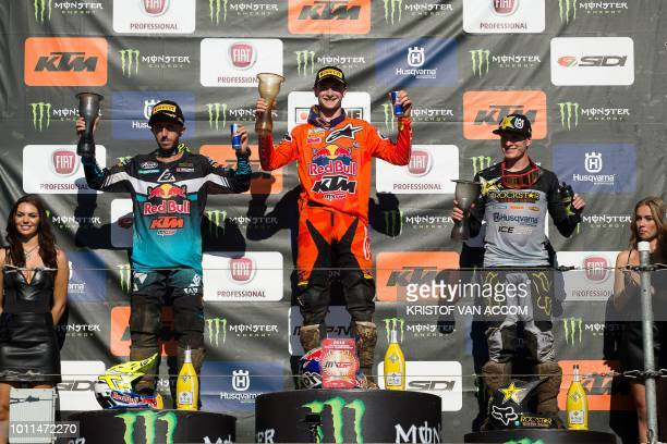 Winner Italy's Antonio Cairoli secondplaced Netherlands' Jeffrey Herlings and thirdplaced Britain's Max Anstie celebrate on the podium after the...