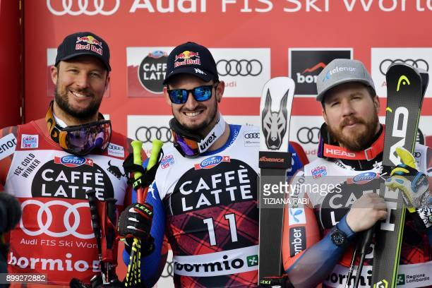 Winner Italy's Dominik Paris secondplaced Norway's Aksel Lund Svindal and thirdplaced Norway's Kjetil Jansrud celebrate on the podium after the FIS...