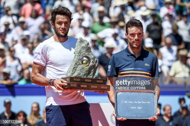 Winner Italy's Matteo Berrettini poses with the trophy next to Spain's Roberto Bautista Agut after their Swiss Open ATP 250 tennis tournament final...
