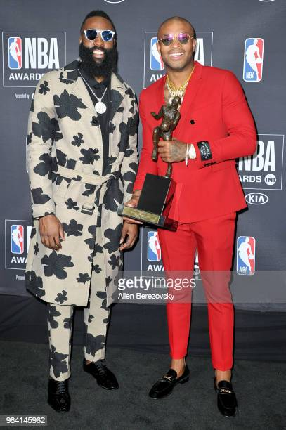 MVP winner James Harden poses with PJ Tucker in the backstage photo room during the 2018 NBA Awards Show at Barker Hangar on June 25 2018 in Santa...