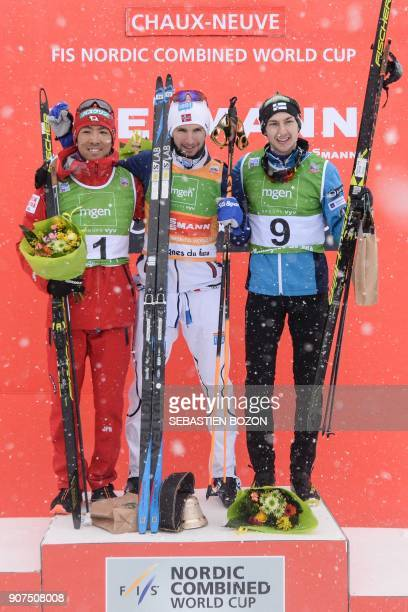 Winner Jan Schmid of Norway poses on the podium with secondplaced Akito Watabe of Japan and thirdplaced Ikka Herola of Finland at the end of the...