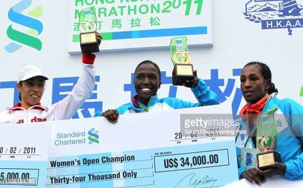 Winner Janet Jelagat Rono of Kenya First Runnerup Samira Raif of Morocco and Second Runnerup Yeshimebet Tadesse Bifa of Ethiopia reacts on the podium...