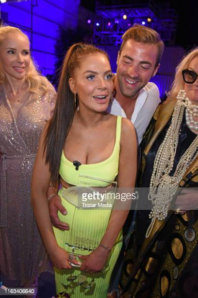 Winner Janine Pink and her boyfriend Tobias Tobi Wegener attend the Promi Big Brother final at MMC Studios on August 23 2019 in Cologne Germany