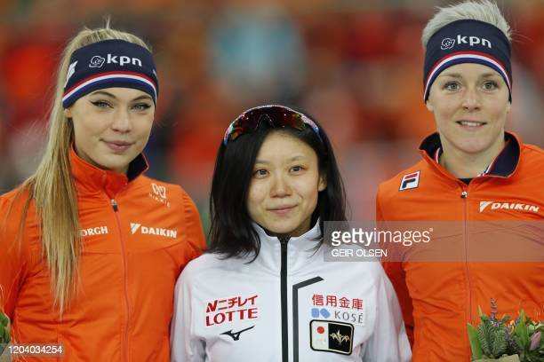Winner Japanese Miho Takagi second placed Jutta Leerdam from The Netherlands and third placed Jorien Ter Mors from The Netherlands celebrate after...