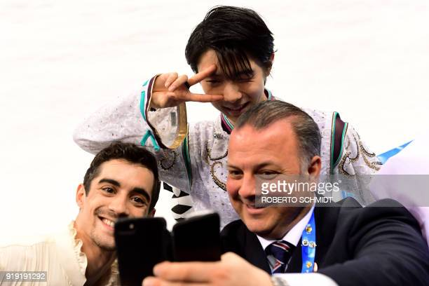 TOPSHOT Winner Japan's Yuzuru Hanyu poses for a photo with Japan coach Ghislain Briand and thirdplaced Spain's Javier Fernandez during the venue...