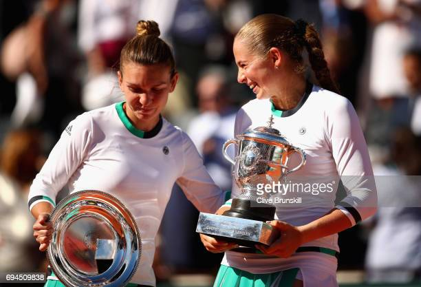 Winner, Jelena Ostapenko of Latvia and Runner up, Simona Halep of Romania share a joke as they hold their trophies following the ladies singles final...