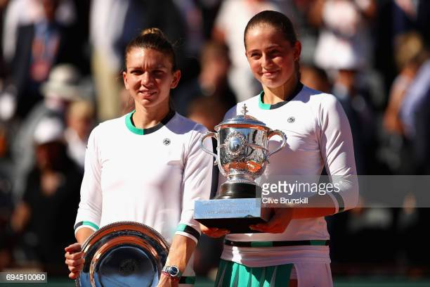 PARIS FRANCE JUNE Winner Jelena Ostapenko of Latvia and Runner up Simona Halep of Romania hold their trophies following the ladies singles final...